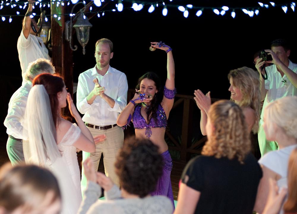 Lara entertains guests at a wedding.